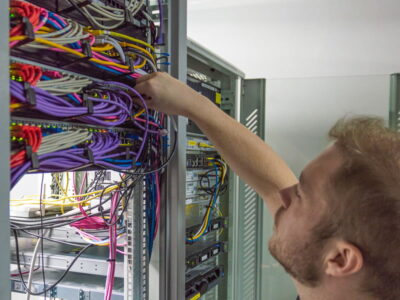 OES IT Engineer working on a server