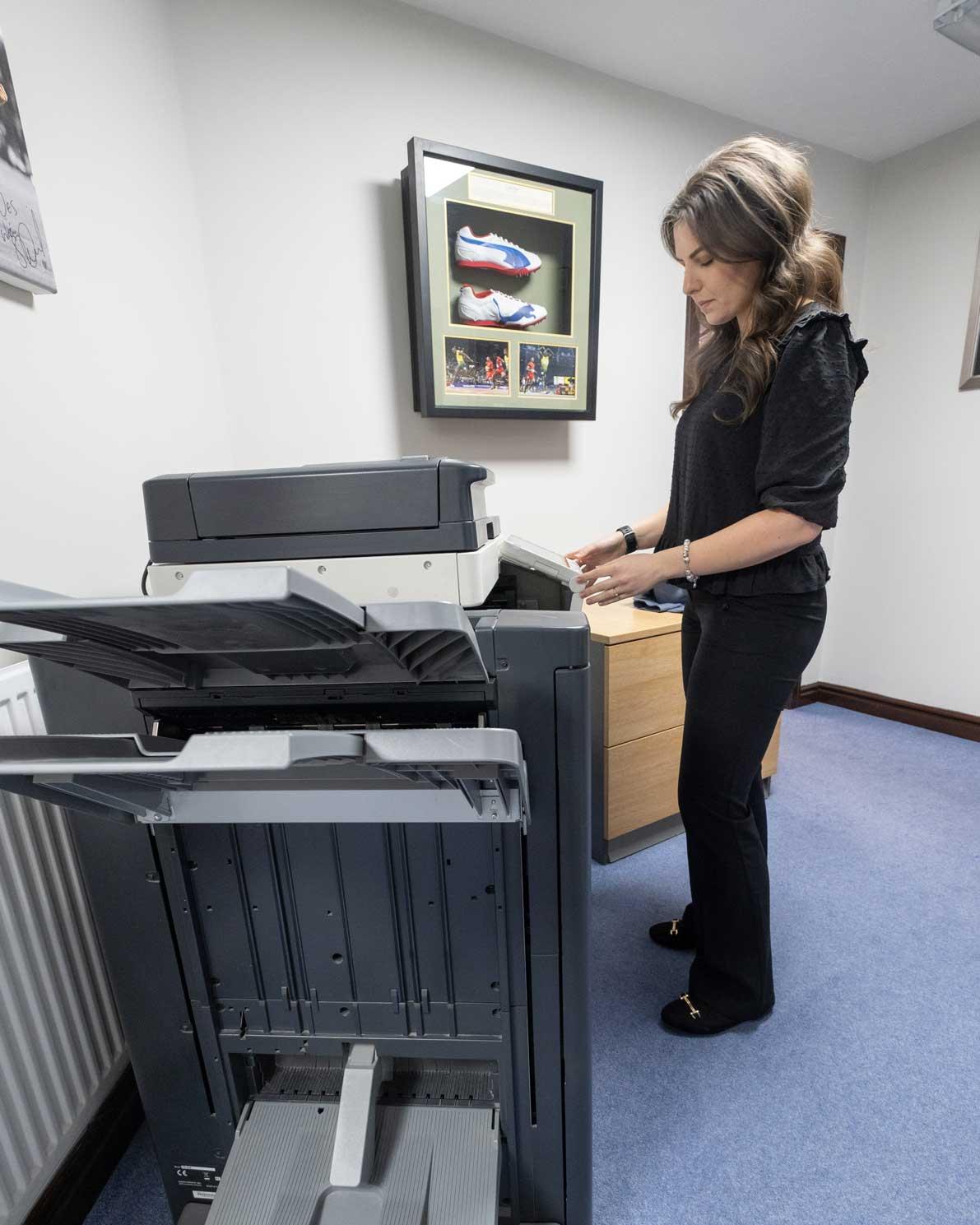 Woman using MFD Printer